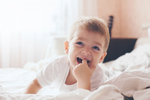 child laughing on the bed language development speecheasy