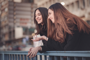 facts about stuttering two girls laughing talking speecheasy